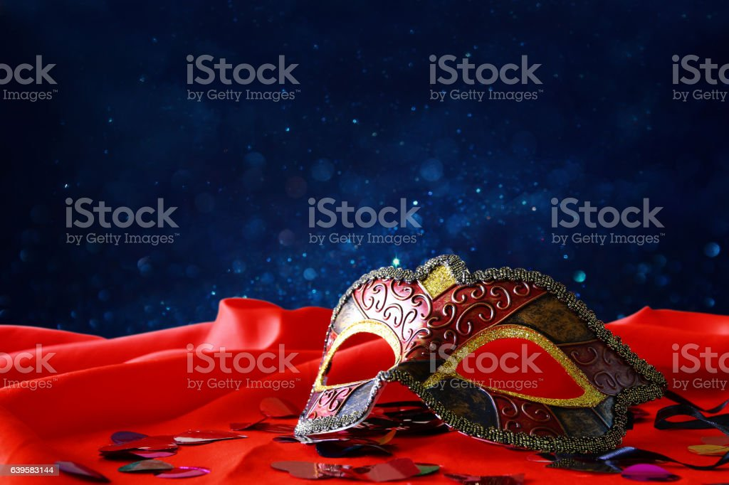 elegant venetian mask on red silk background stock photo