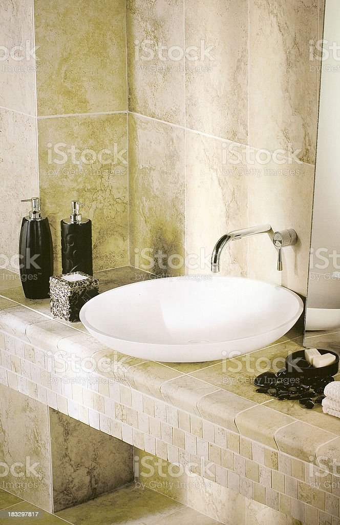 Elegant Vessel Sink and Faucet on Marble Tile Counter royalty-free stock photo