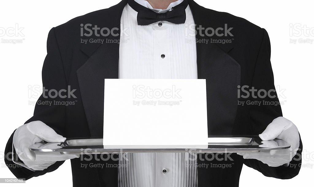 Elegant waiter brings an invitation stock photo