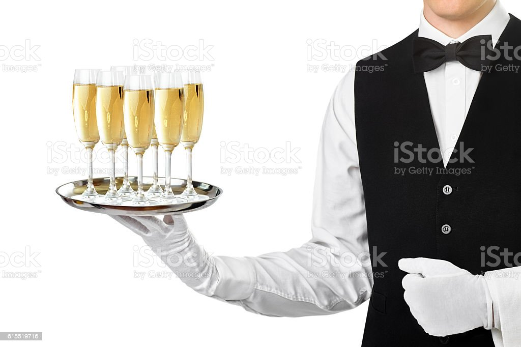 Elegant waiter serving champagne on a tray stock photo
