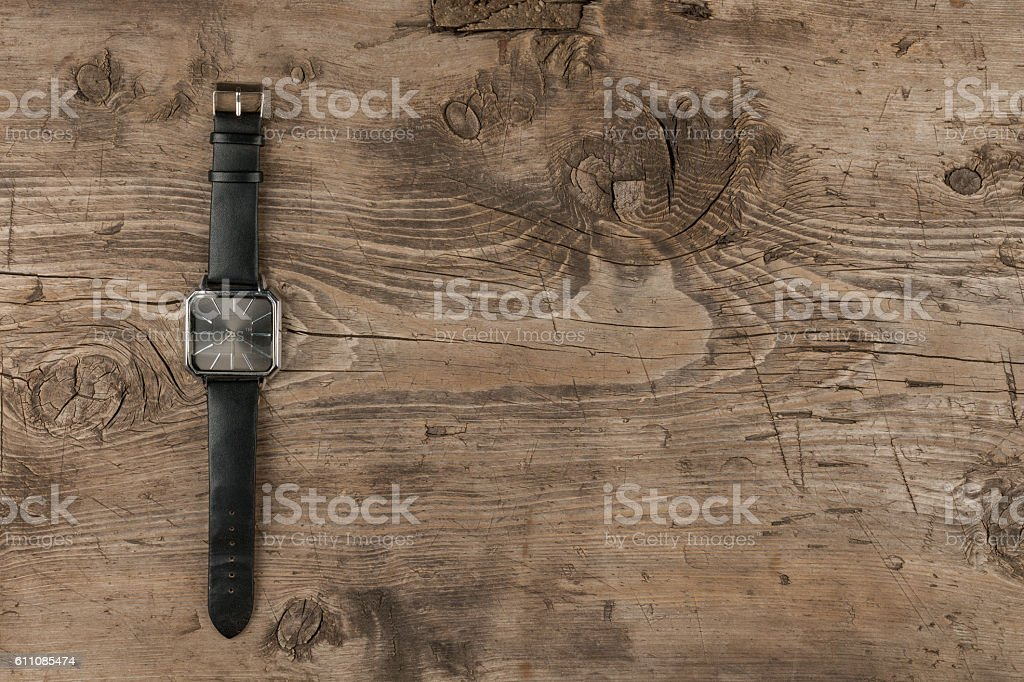 Elegant watches lying on a wooden surface stock photo