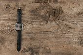 Elegant watches lying on a wooden surface