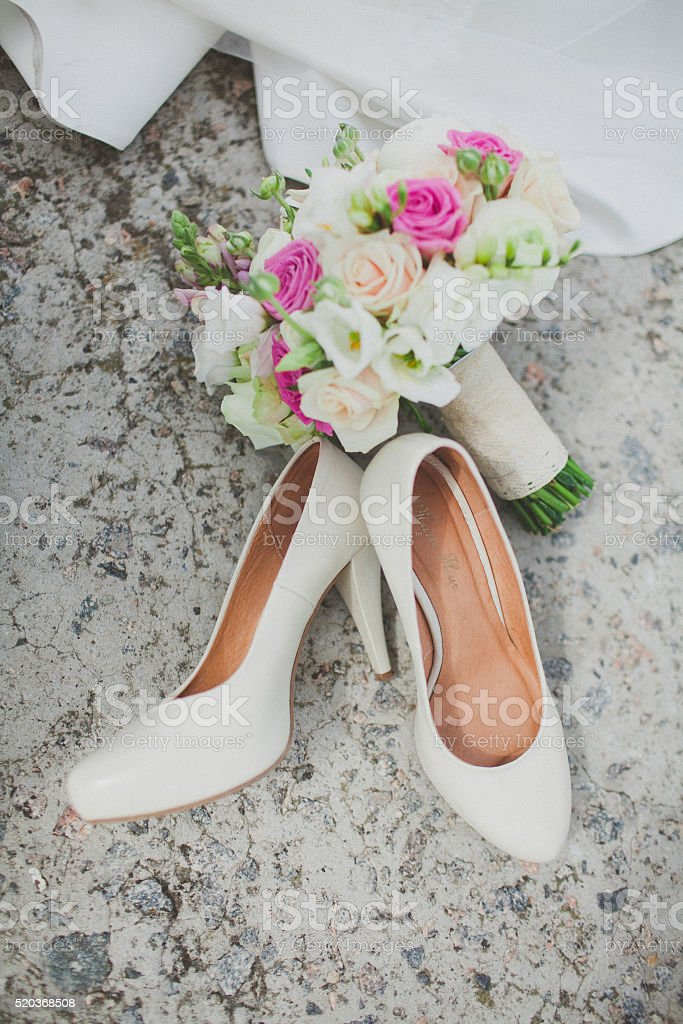 Elegant wedding shoes stock photo