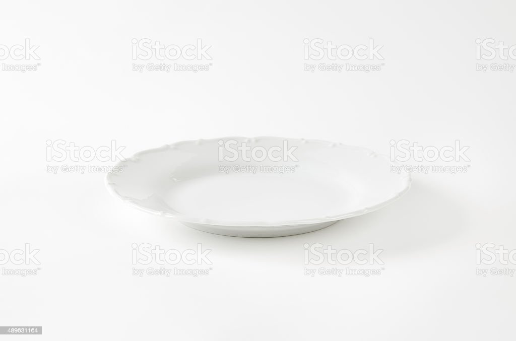 Elegant white dinner plate stock photo