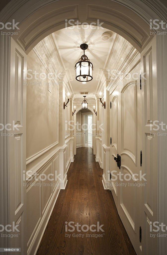 Elegant white hallway with hardwood floor. stock photo