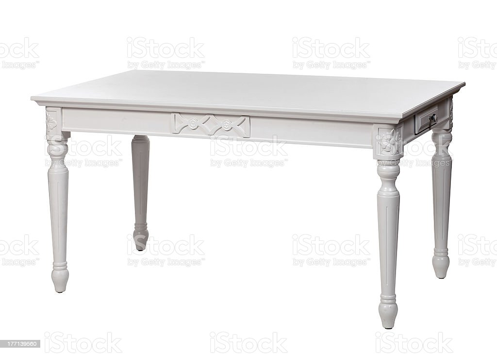 Elegant white table with some designs carved into the edges royalty-free stock photo