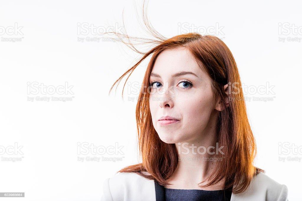 elegant woman blowing away her hair stock photo