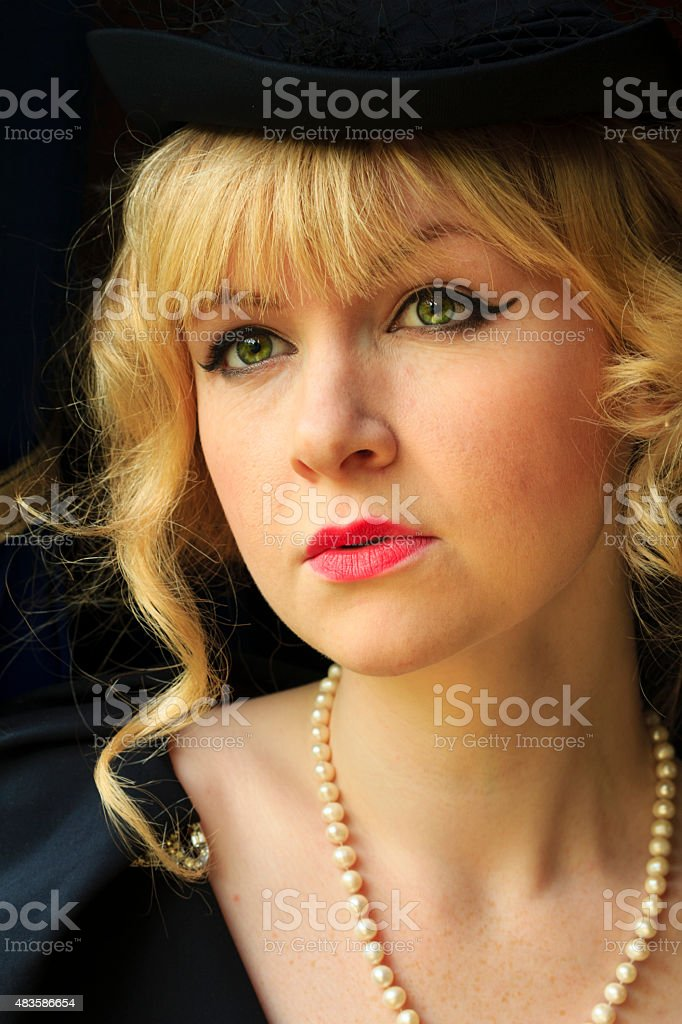 Elegant woman dressed in 1950's vintage style / fashion stock photo