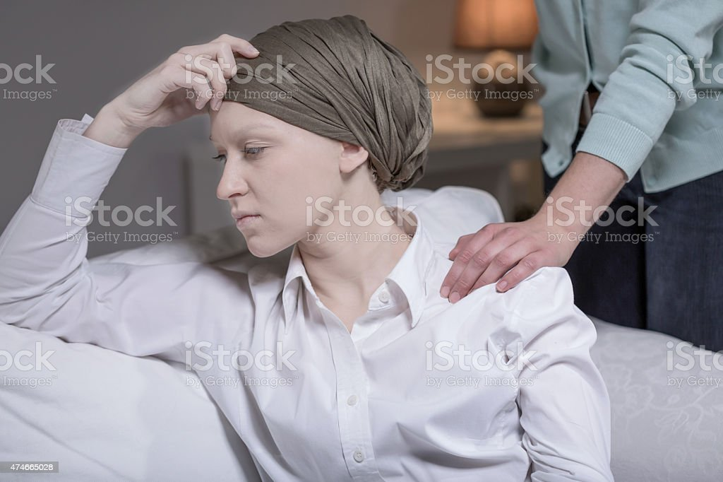 Elegant woman having breast cancer stock photo