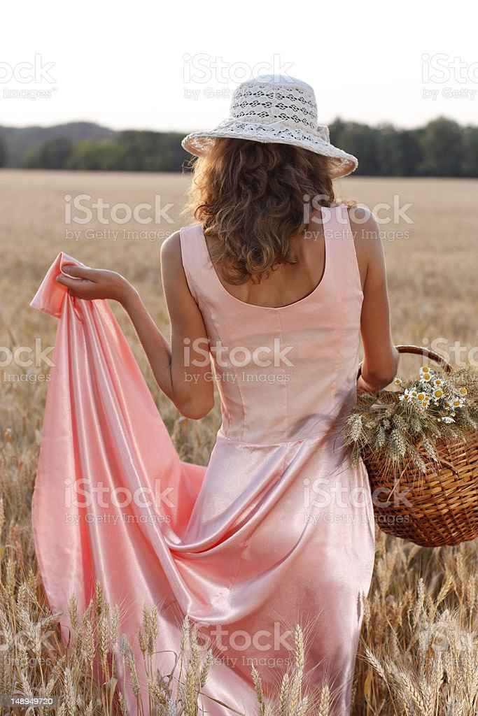 Elegant woman in a dress and hat with basket stock photo