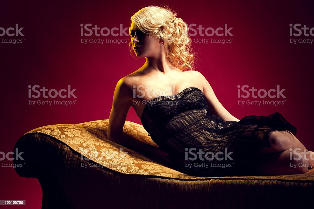 Elegant Woman in Evening Gown stock photo