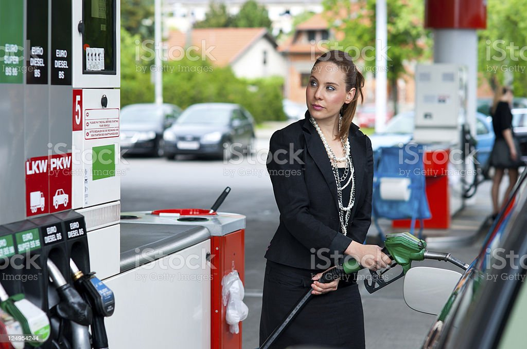 elegant woman in gas station stock photo