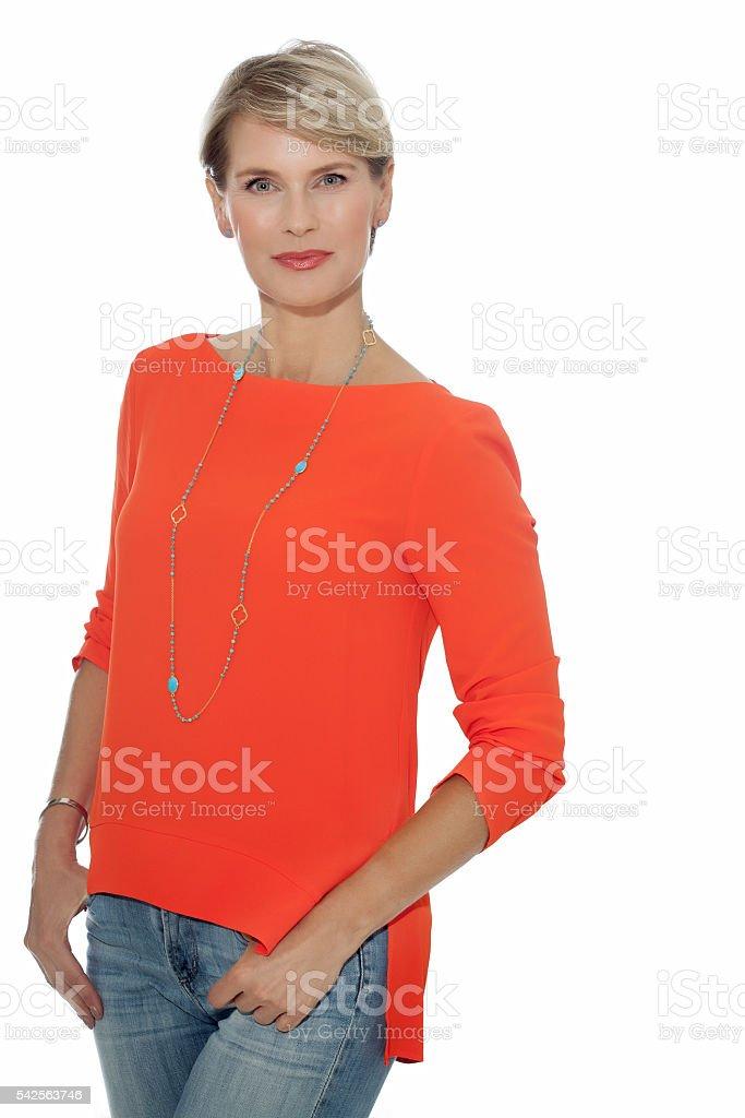 Elegant Woman In Orange Blouse stock photo