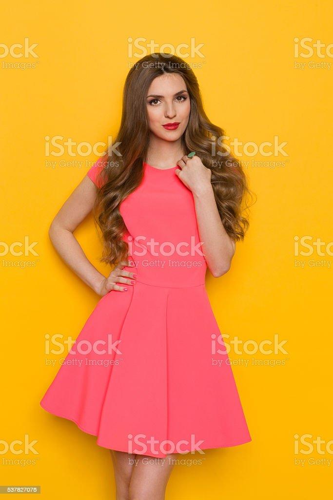Elegant Woman In Pink Dress stock photo