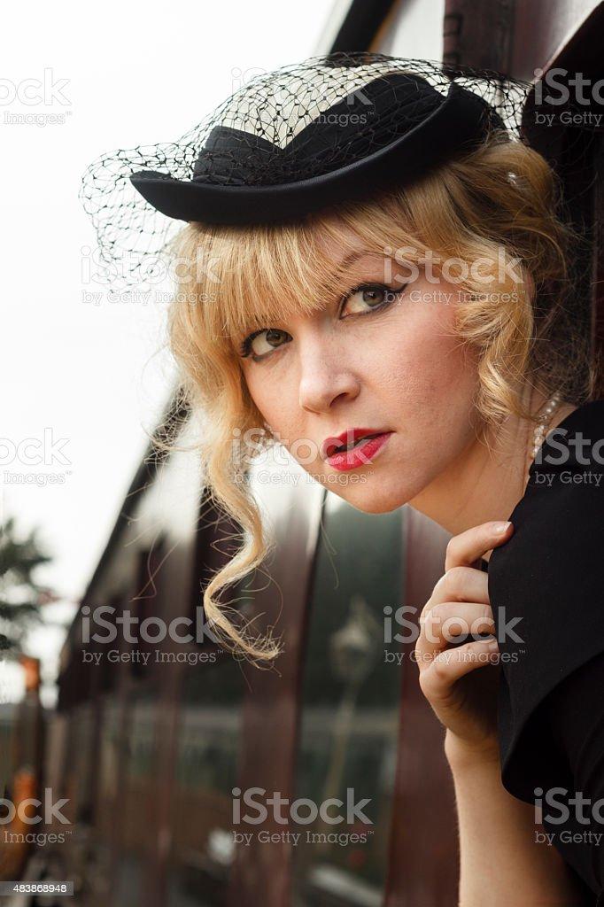 Elegant woman in retro fashion on a steam train stock photo