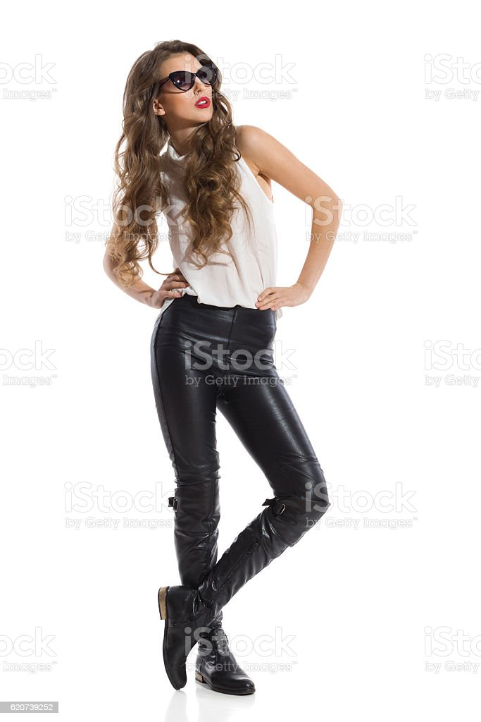 Elegant Woman In White Shirt And Black Leather Trousers stock photo