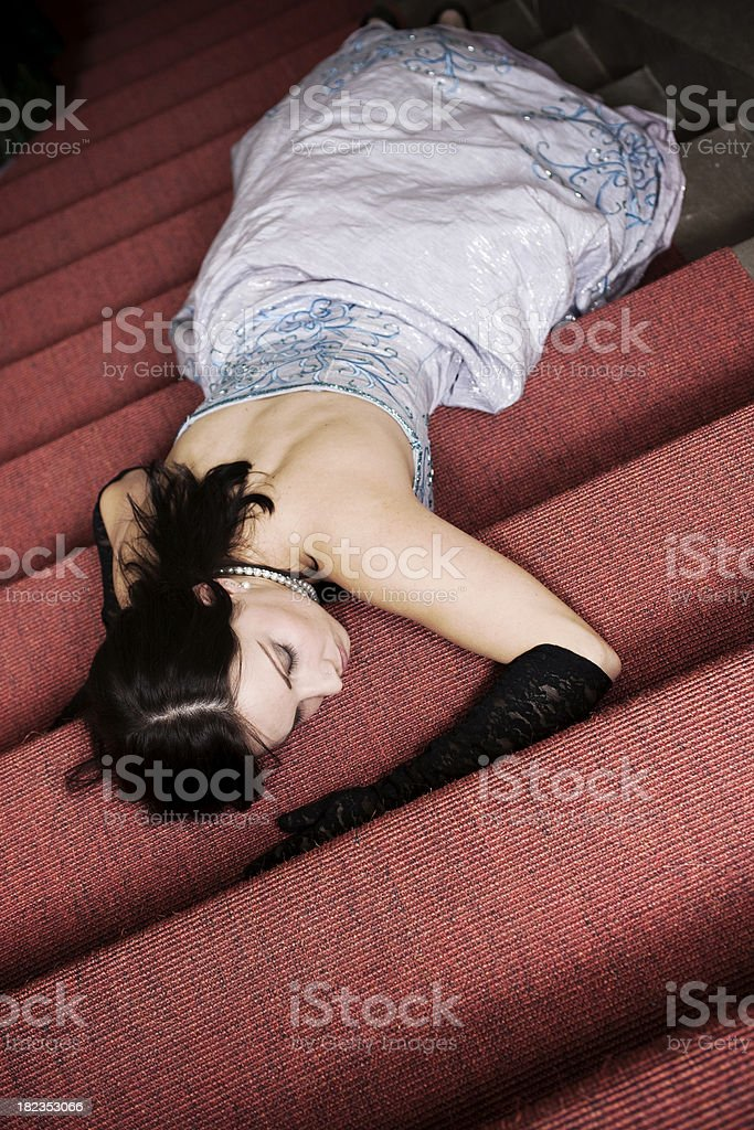 Elegant woman laying on the stairs royalty-free stock photo