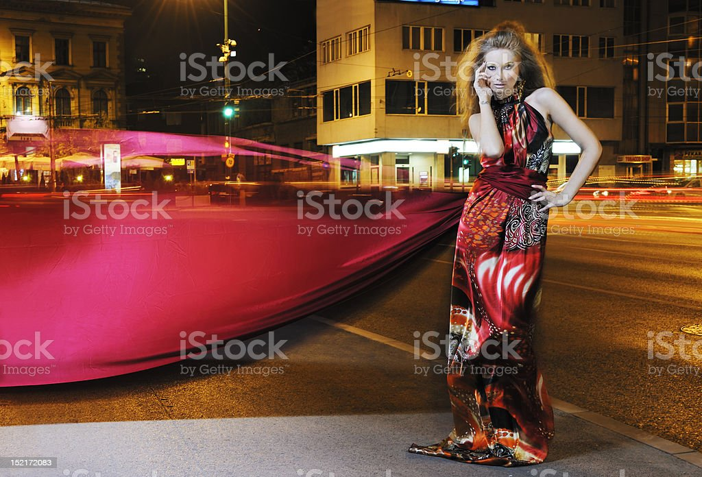 elegant woman on city street at night royalty-free stock photo