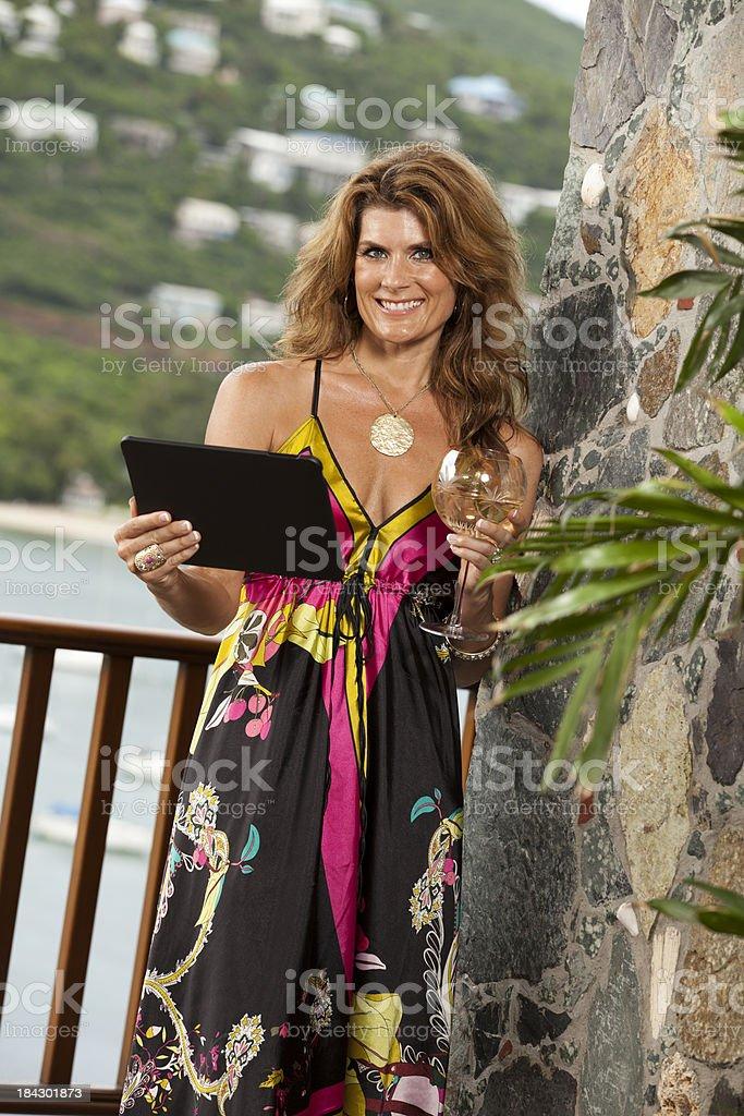 Elegant Woman on her digital tablet stock photo