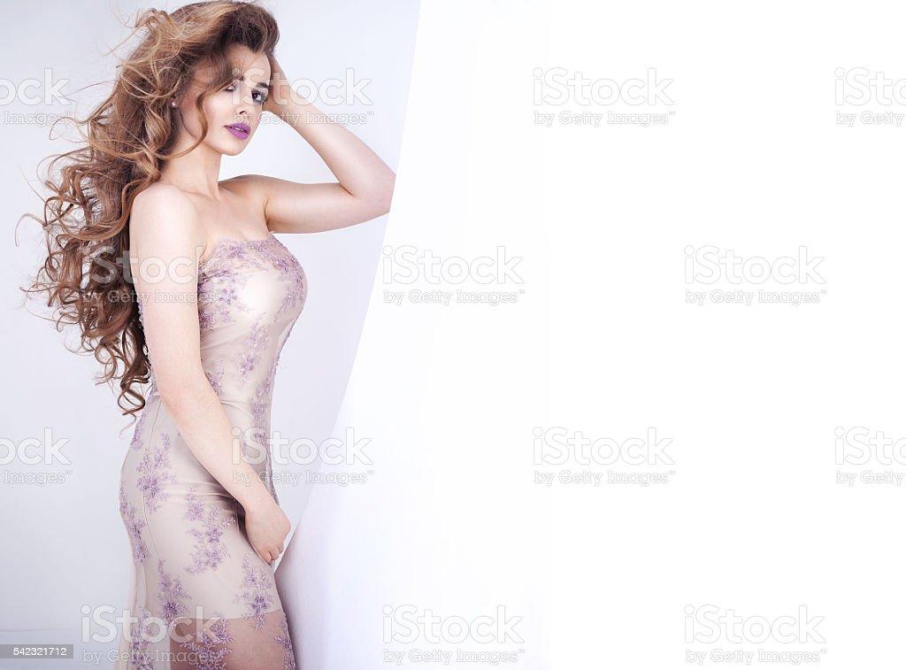 Elegant woman posing in studio. stock photo