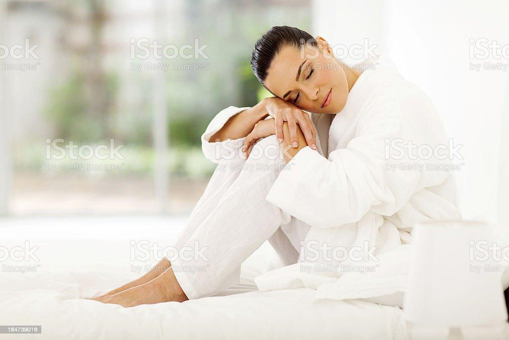 elegant woman sitting on bed royalty-free stock photo