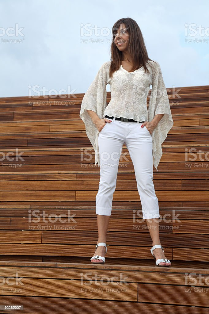 Elegant woman standing on stairs royalty-free stock photo