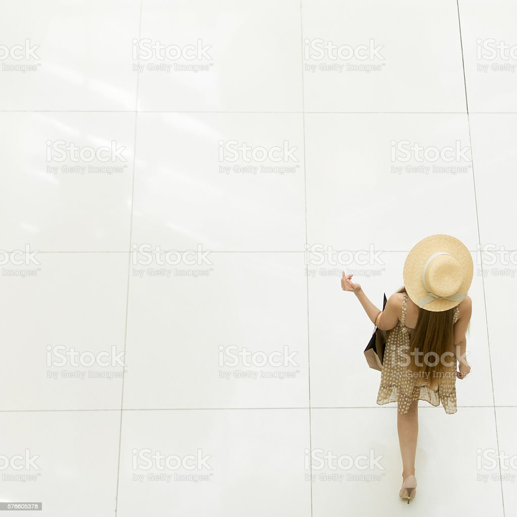 Elegant woman walking in shopping centre. Overhead view stock photo