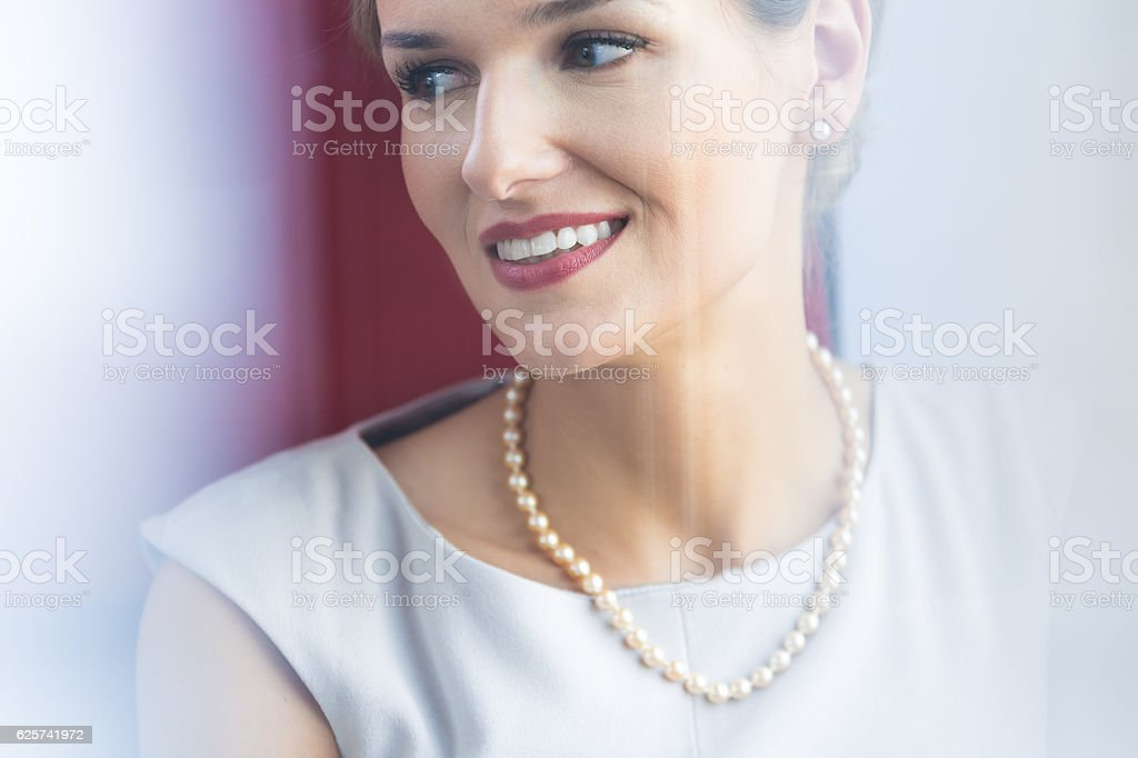 Elegant woman wearing pearl jewelry stock photo