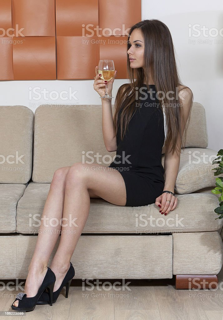 Elegant woman with a glass of wine royalty-free stock photo