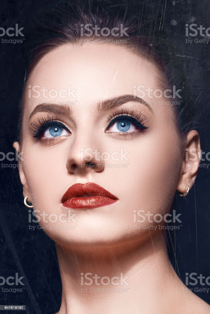elegant woman with blue eyes stock photo