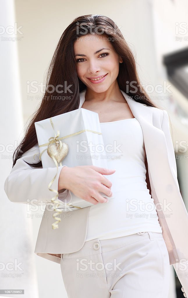 Elegant woman with gift stock photo