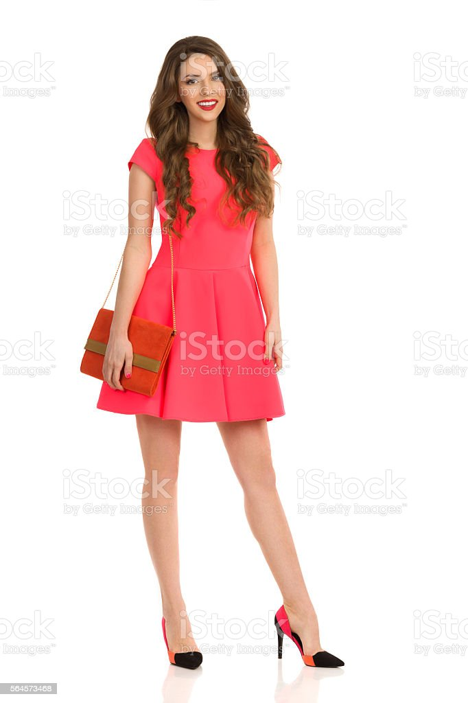 Elegant Woman With Orange Handbag stock photo