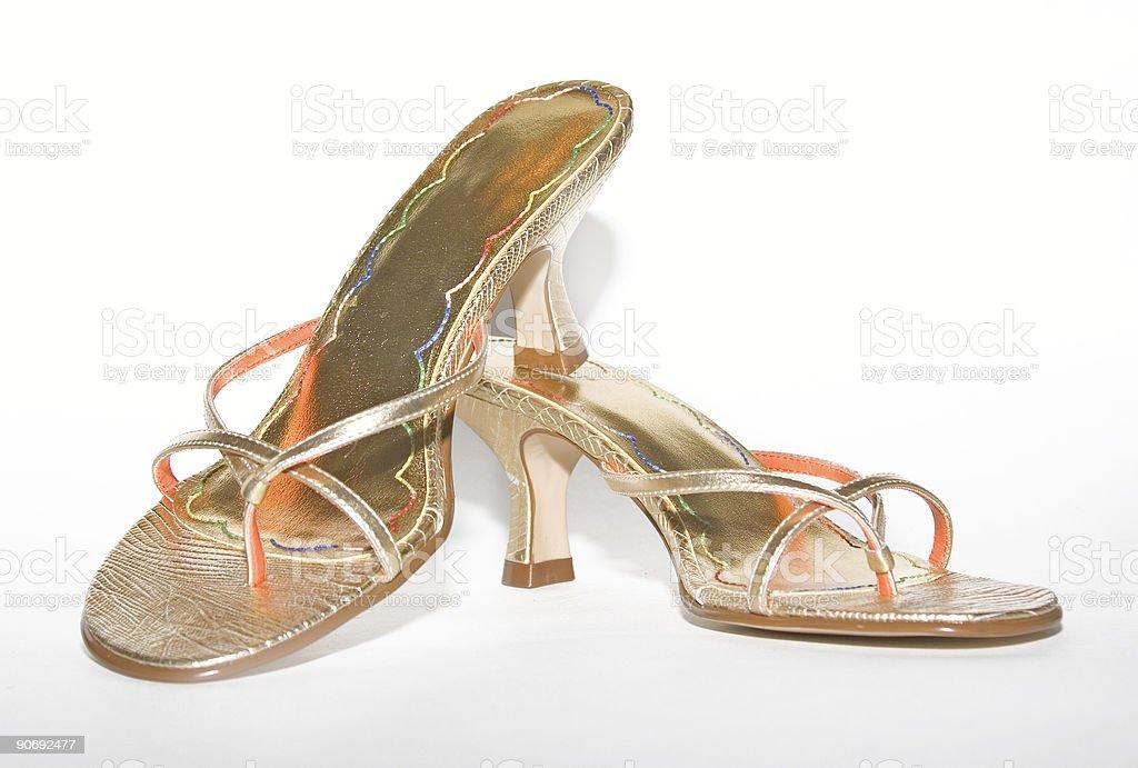 elegant women gold shoes royalty-free stock photo