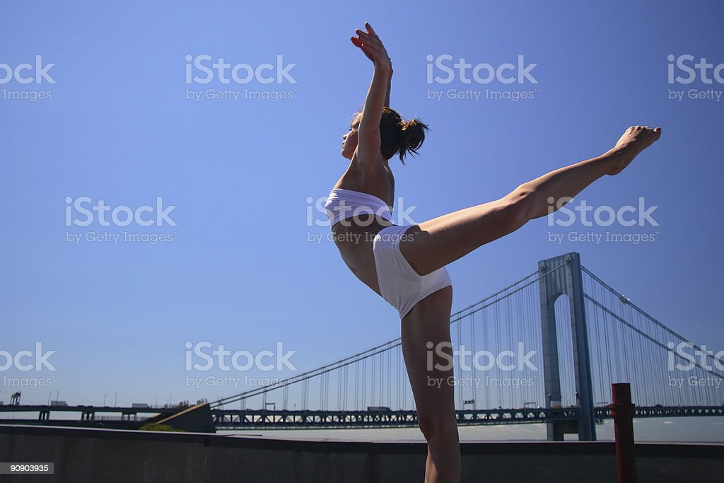 Elegant Young Gymnast Excercising on a Roof, Leg Raised royalty-free stock photo