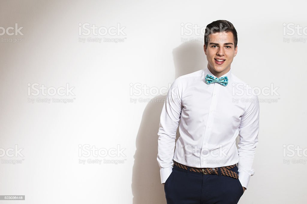 Elegant young handsome man  Studio fashion portrait. Copy space stock photo