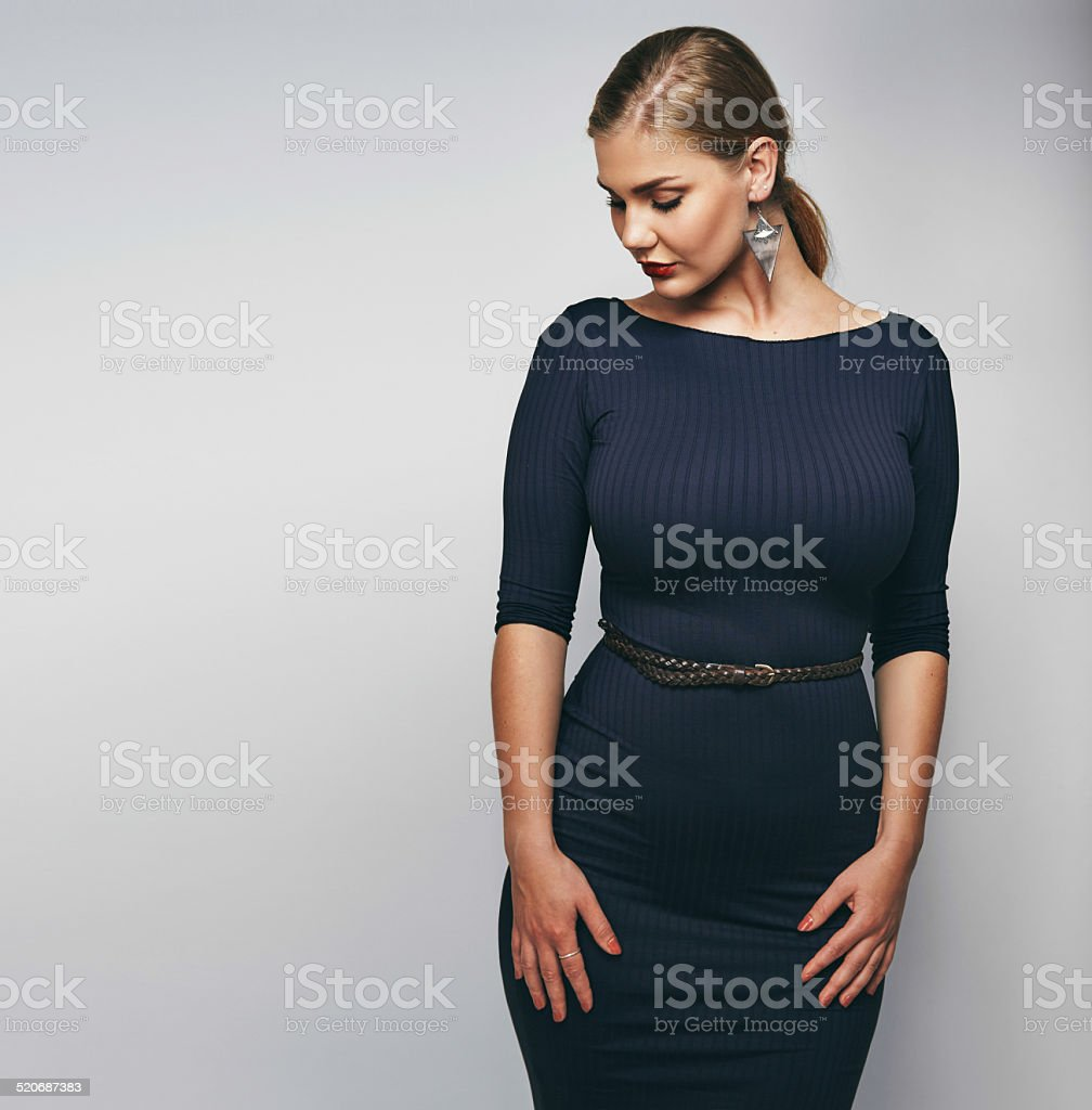 Elegant young lady in black dress stock photo