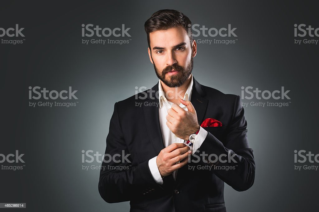 Elegant young man getting ready. stock photo