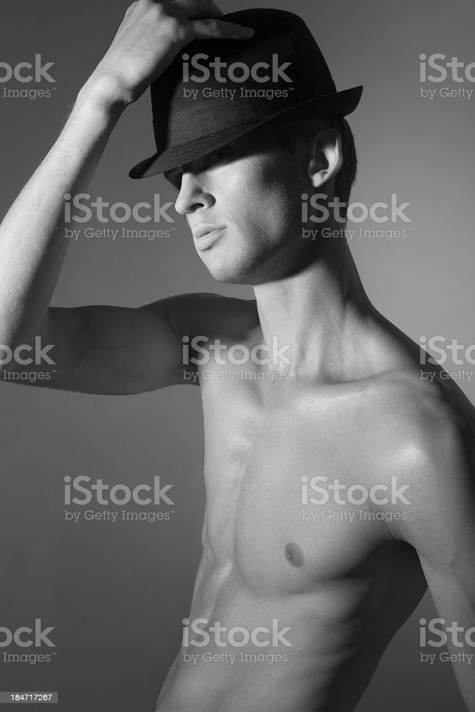 Elegant young man in hat. Black and White Portrait royalty-free stock photo