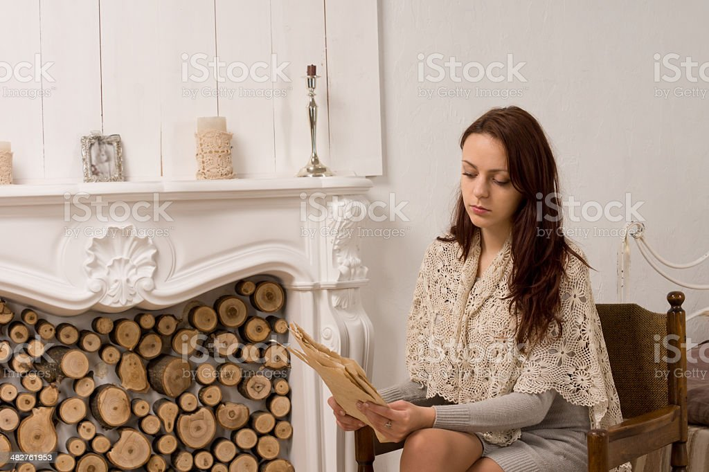 Elegant young woman sitting reading royalty-free stock photo