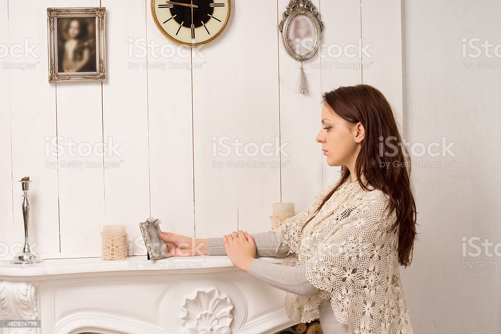 Elegant young woman staring at on old portrait royalty-free stock photo