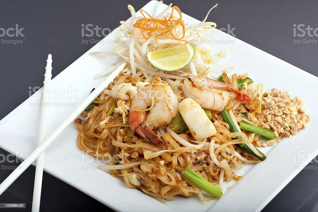 Elegantly plated seafood Pad Thai with fried rice stock photo