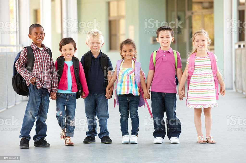 Elementary Age Schoolchildren Standing Outside stock photo