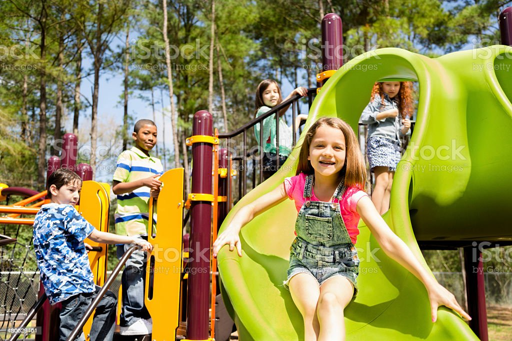 Elementary children play at school recess or park on playground. royalty-free stock photo
