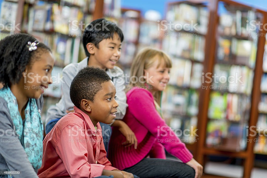 Elementary library kids stock photo
