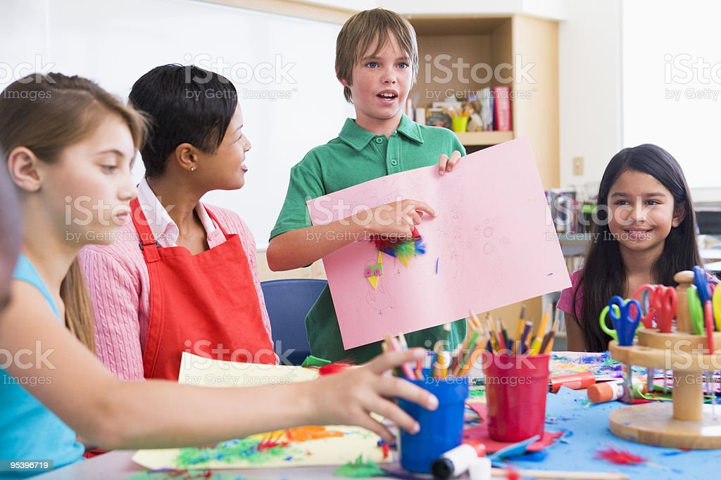 Elementary pupil discussing picture royalty-free stock photo