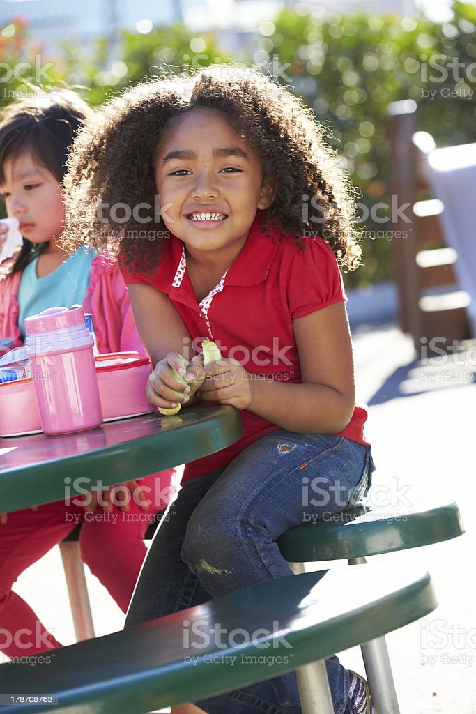 Elementary Pupil Sitting At Table Eating Lunch royalty-free stock photo
