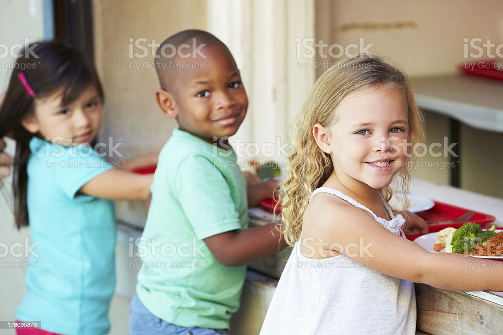 Elementary Pupils Collecting Healthy Lunch In Cafeteria stock photo