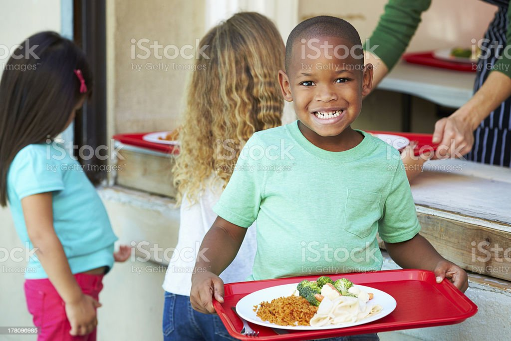 Elementary Pupils Collecting Healthy Lunch In Cafeteria royalty-free stock photo
