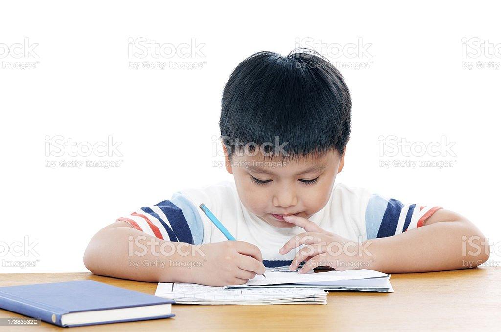 Elementary School Boy Doing His Schoolwork royalty-free stock photo