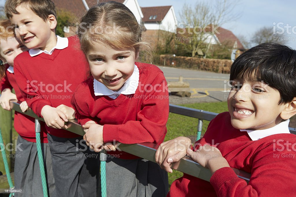 Elementary school pupils in playground royalty-free stock photo